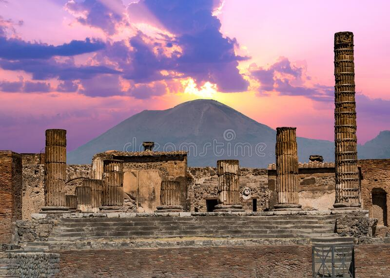 Pompeii and Mount Vesuvius against a vibrant sunset stock photos