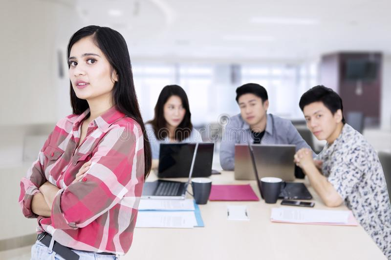 Female business leader folded hands near her team royalty free stock images