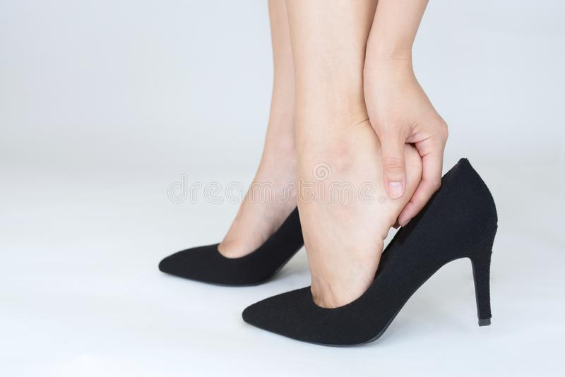 Woman feet pain wear high heel shoes. A picture of female feet in pain after wearing high heeled shoes royalty free stock images