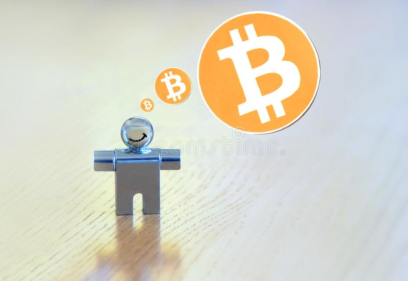 Bitcoin thought bubble. Picture figuratively showing a smiling person thinking about bitcoins. Sony DSLR, Tamron 90mm royalty free stock image