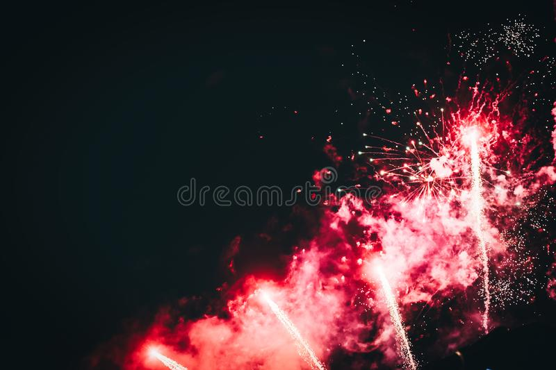 Picture of fireworks bursting on night sky stock image