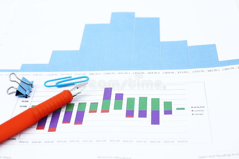 Picture of fountain pen and paper clip on the graph paper.  stock photography