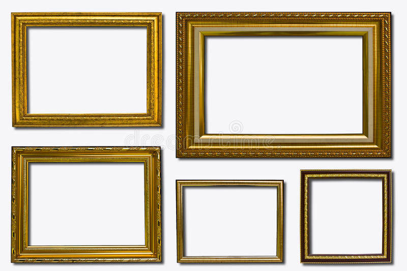 Picture frame. Empty golden picture frame isolated on white. File contains clipping path royalty free stock images