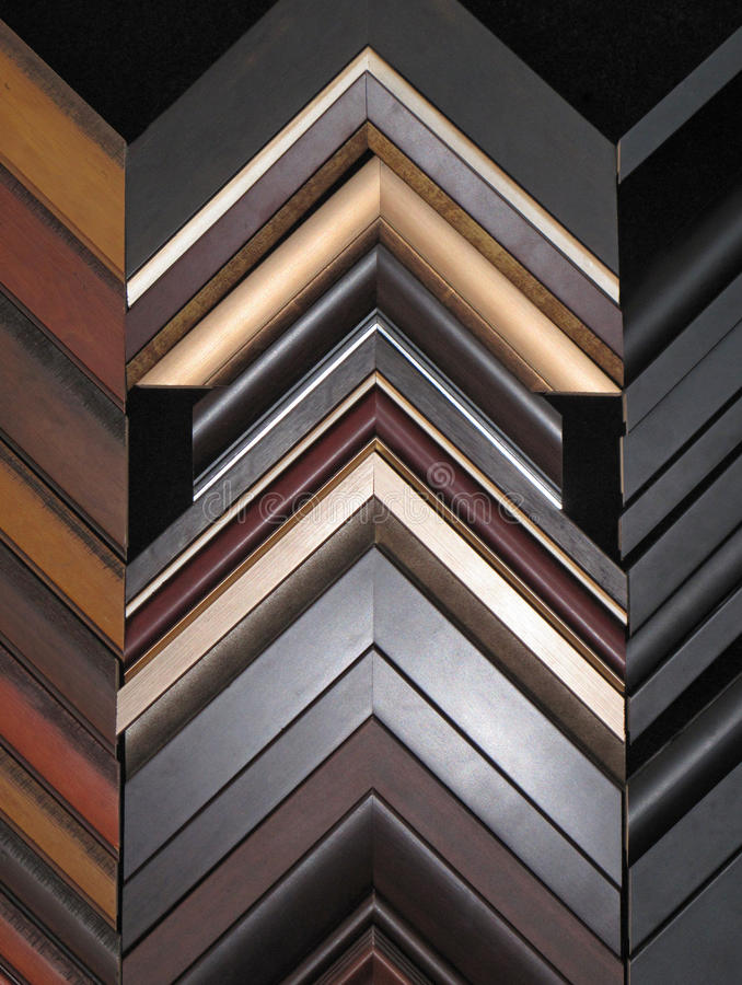 Picture Frame Assortment Shop Display. An assortment shop wall display of modern decor picture frame styles stock photos