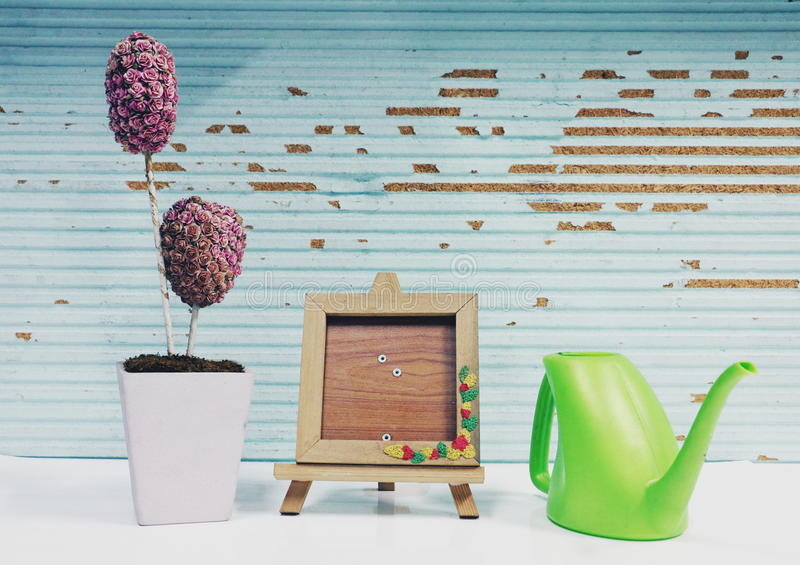 Picture frame , flower and plant. In wood background royalty free stock image