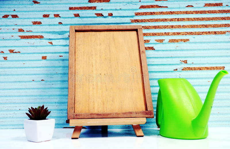Picture frame , flower and plant. In wood background stock photo