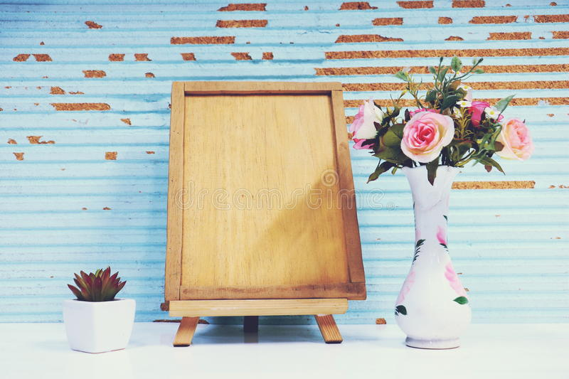 Picture frame , flower and plant. In wood background stock photography
