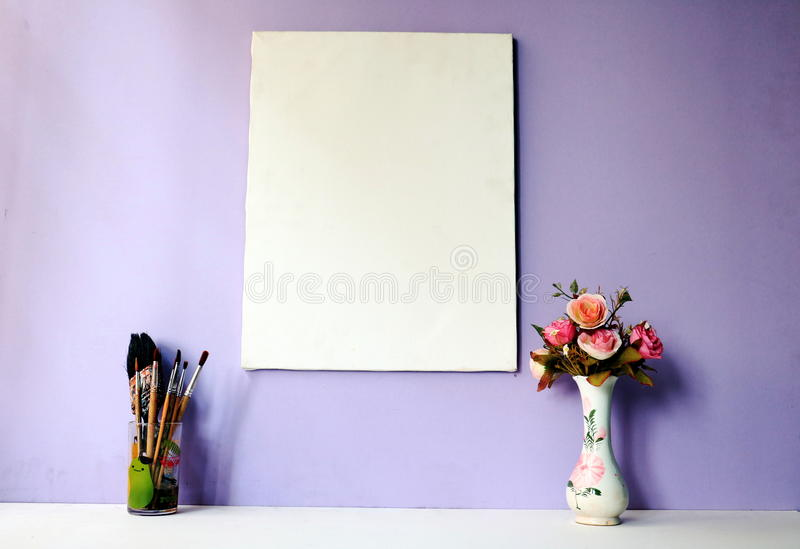 Picture frame , flower and plant. In wood background royalty free stock photography