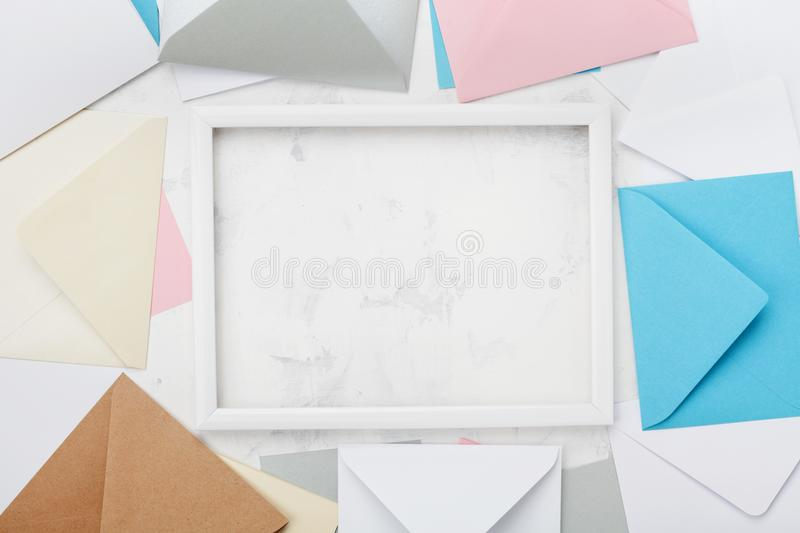 Picture frame with mail envelopes border mockup or template top view. Styled background for correspondence design. Flat lay. royalty free stock images