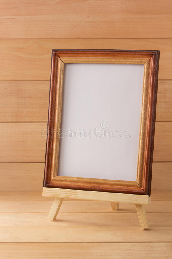 Picture frame on wood royalty free stock image
