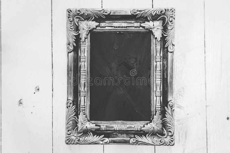 Picture frame on wooden background stock photos