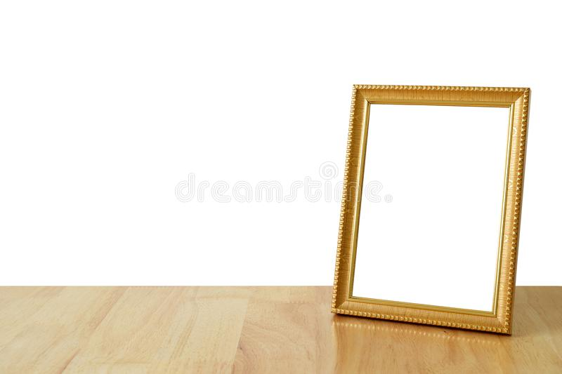 Picture frame on wooden with clipping path. Picture frame on wooden on white background with clipping path royalty free stock image