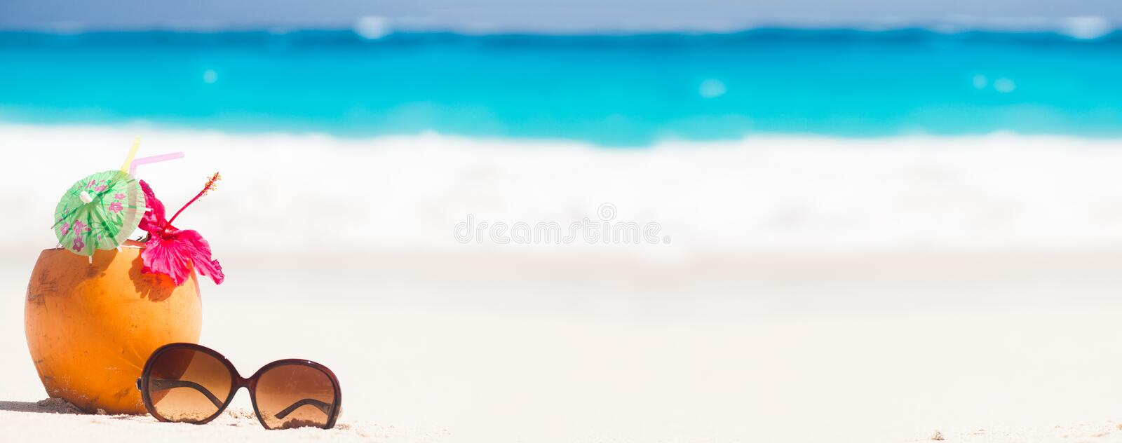 Picture of fresh coconut juice and sunglasses on royalty free stock images