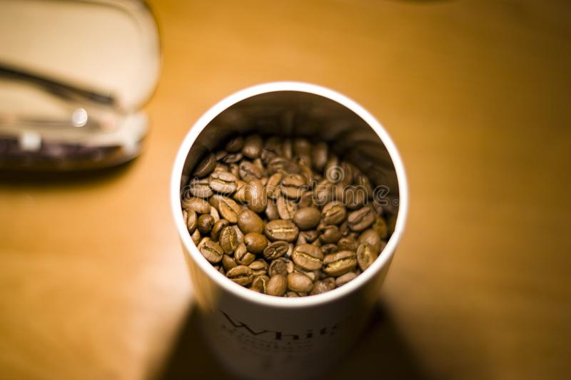 A picture of a fresh coffee beans in a white can stock photos