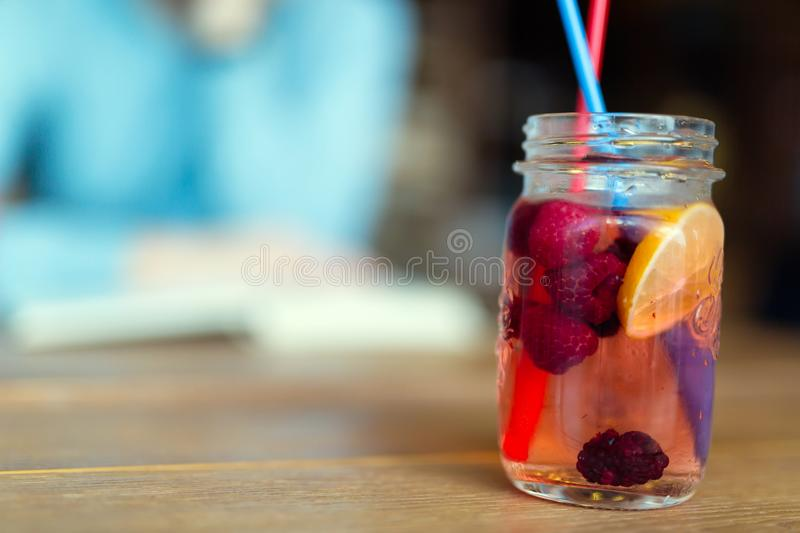 Picture of fruit drink made from rasberry and lemon royalty free stock photography
