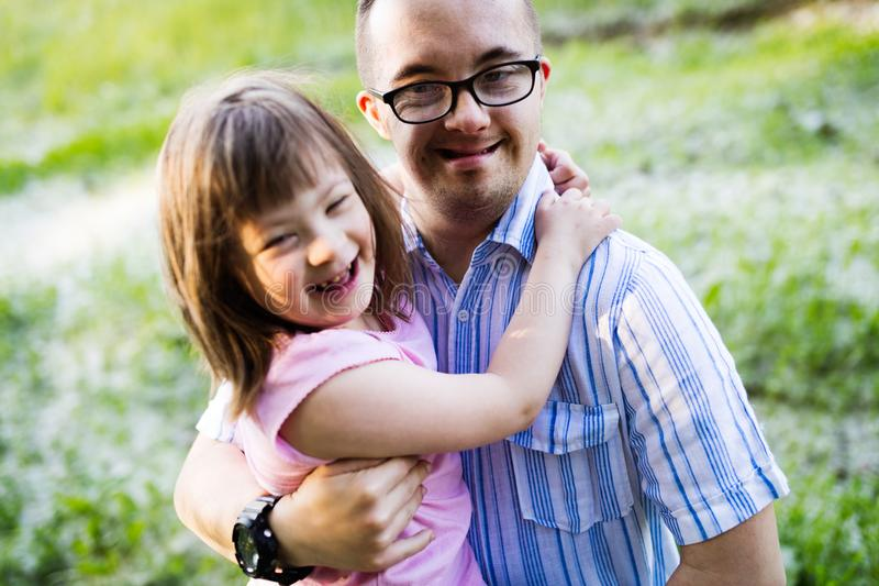 Picture of girl and man with down syndrome stock image