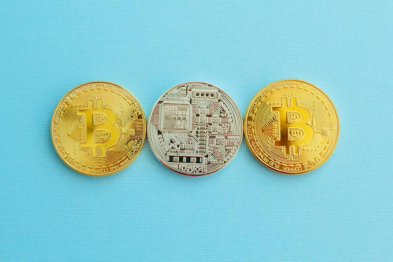 Picture of three gold bitcoin over blue background. Digital money concept stock photos