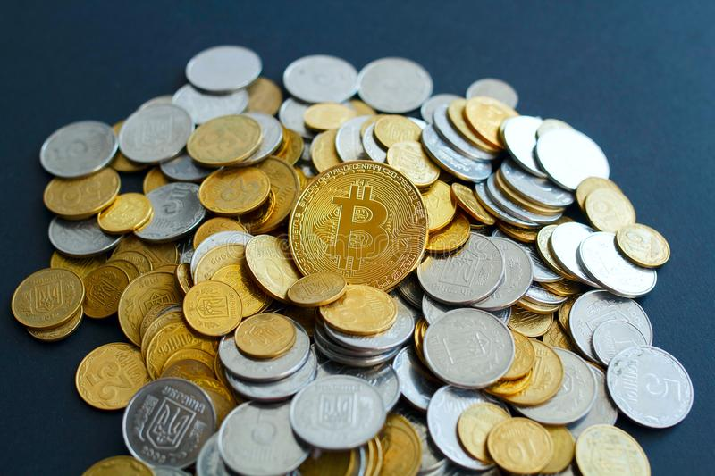 Picture of gold bitcoin over golden money. Digital money concept royalty free stock photos