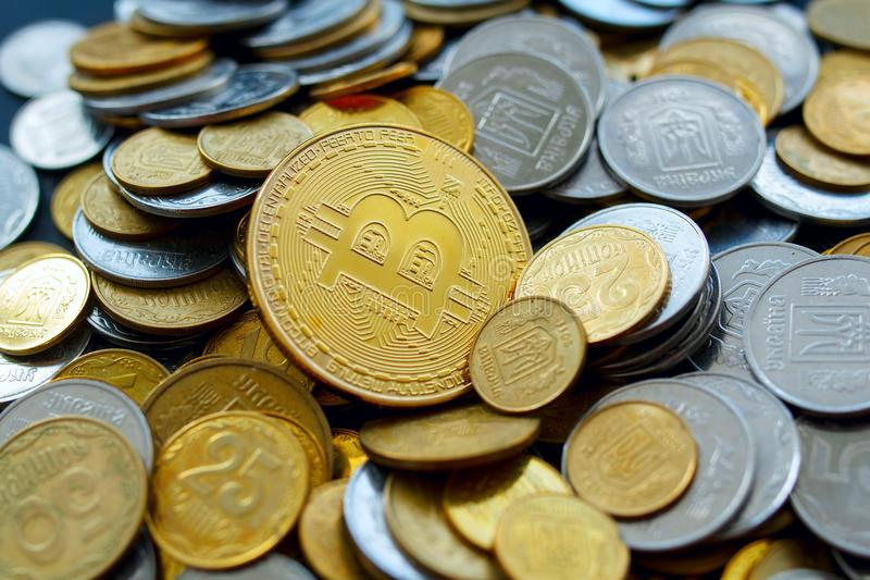 Picture of gold bitcoin over golden money. Digital money concept royalty free stock photography