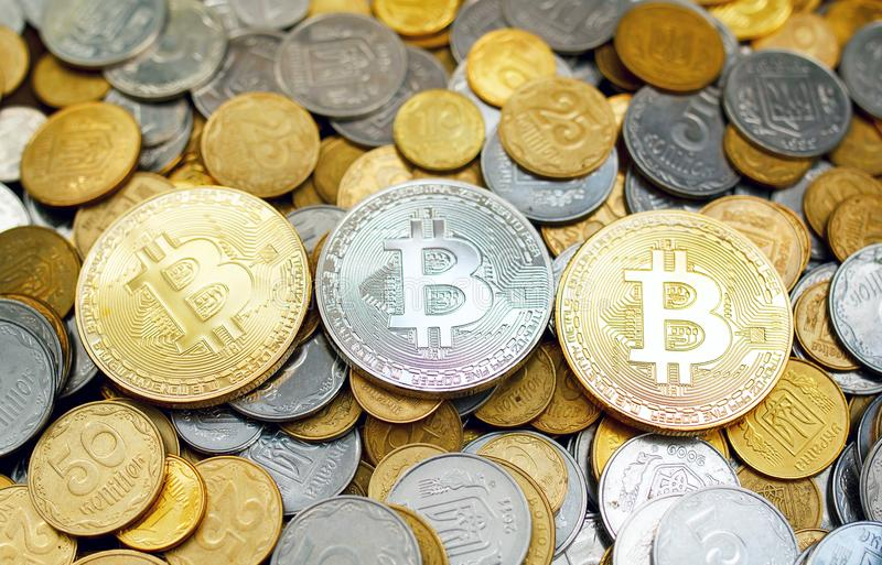 Picture of three gold bitcoin over golden money. Digital money c stock photo