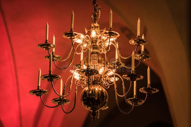 gold-plated chandelier hangs in the old church near the icons. Modern lamps are like candles stock image