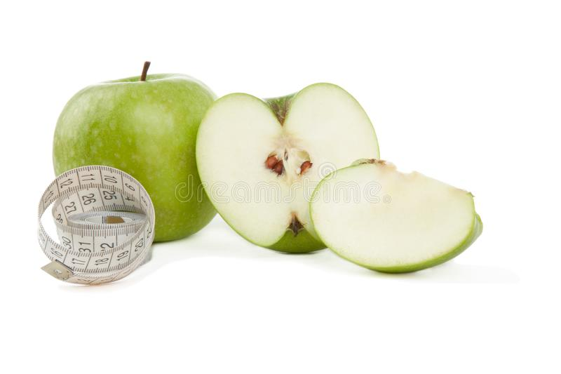 Picture of green apples and tape measure isolated on white royalty free stock photos