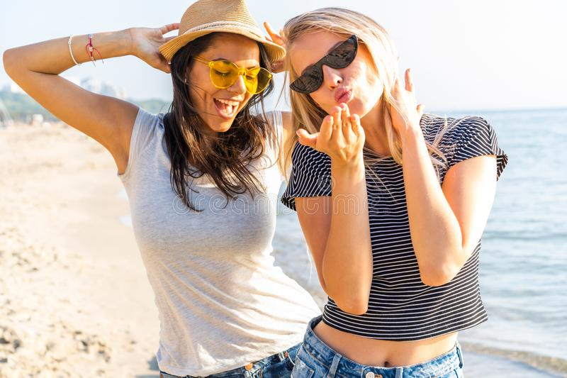 A picture of a group of women having fun on the beach. stock photo