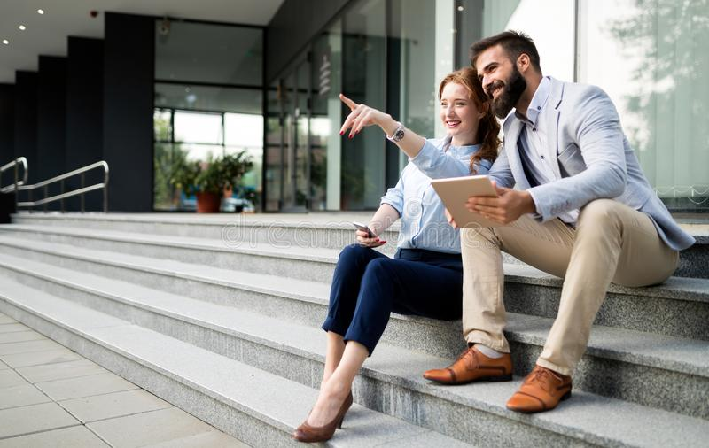 Picture of handsome businessman and attractive businesswoman. On break in front of company royalty free stock photos