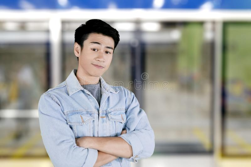 Confident handsome man standing in the campus. Picture of a handsome man looks confident while standing in the campus royalty free stock images