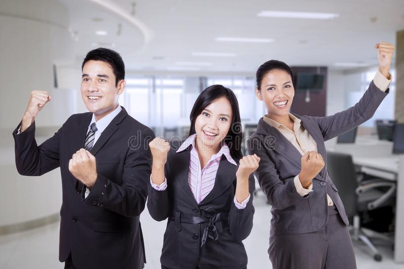 Happy business team celebrating their triumph royalty free stock photo