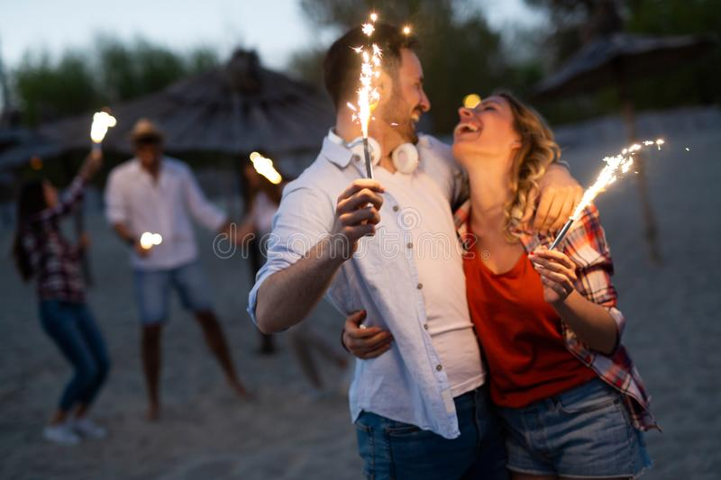 Picture of happy couple holding burning sparkle stock image