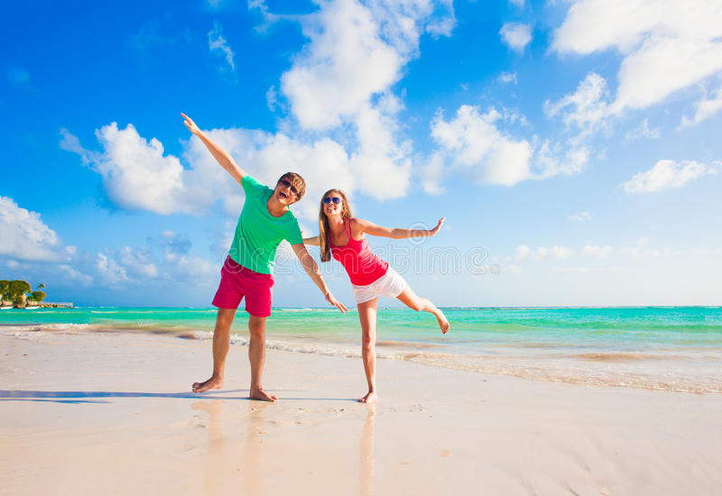 Picture of happy couple in sunglasses on the beach. Remote tropical beaches and countries. travel concept stock photography
