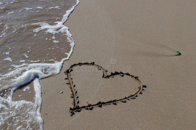 Seascape. Love, summer, sea, sun, beach, fun, holiday and a big heart on the sand stock photos