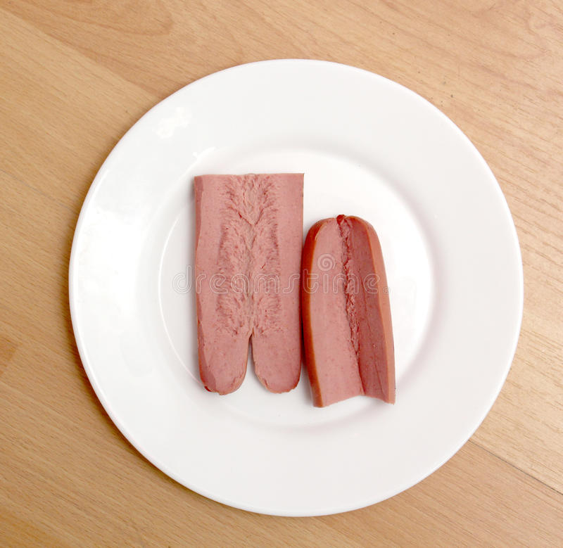 Picture of a hot dog sausage on white plate stock photo