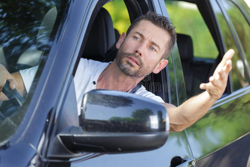 Picture impatient male driver. Picture of impatient male driver royalty free stock images