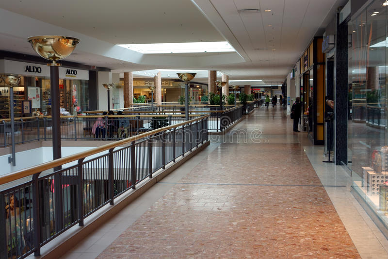 Picture inside a mall. The upper level of a massive shopping complex royalty free stock photos