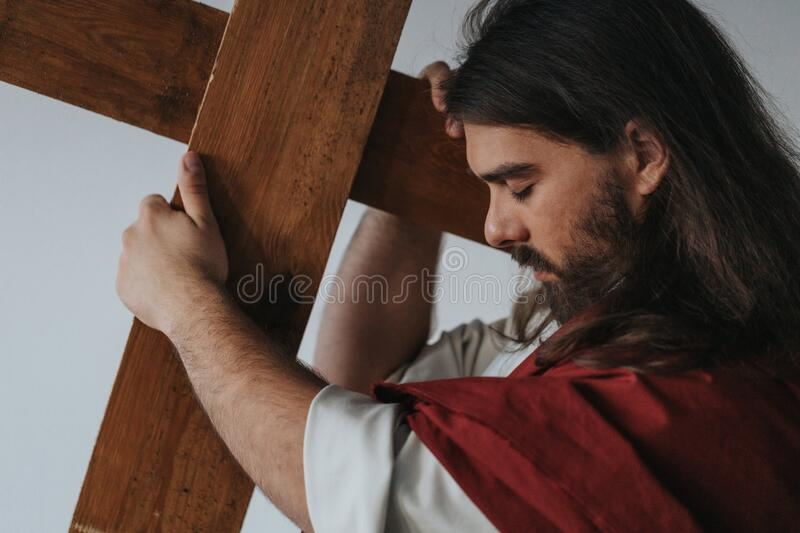 Carrying the cross stock photos
