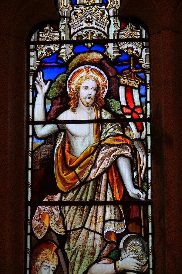 Jesus Christ on stained glass window. A picture of Jesus Christ ascending from the cross on a stained glass window in a church in England royalty free stock photo
