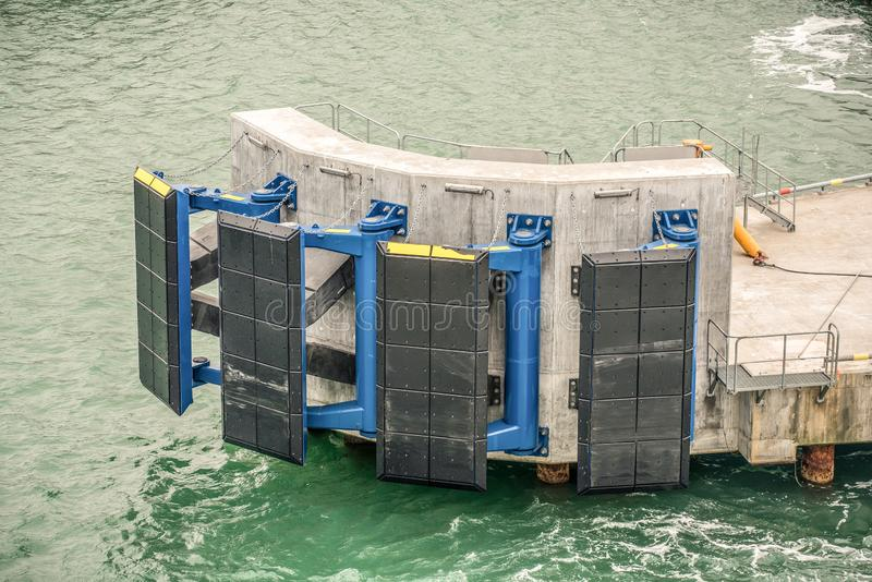 Jetty fender system to protect the jetty from ship damage stock photography