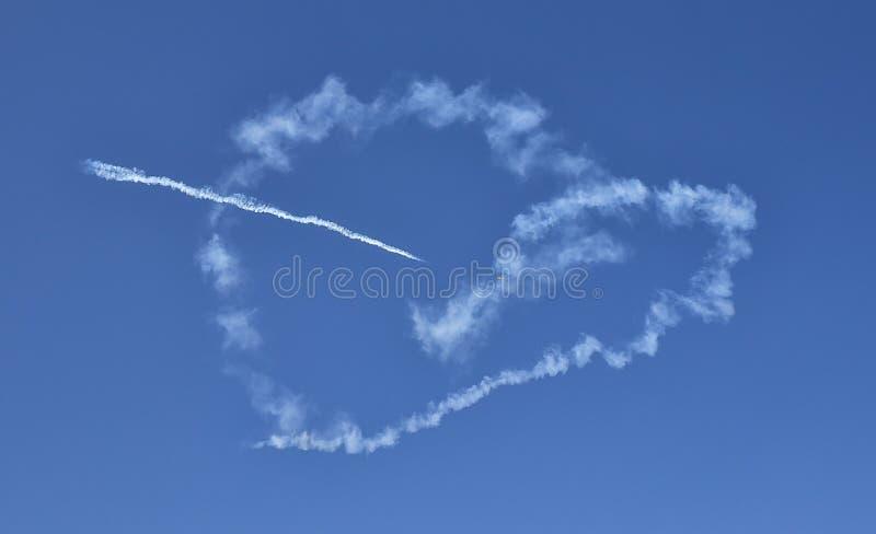 Jurgis Kairys heart plane at Bucharest Aeronautic show. Picture with Jurgis Kairys on the sky at Bucharest Aeronautic show stock photography