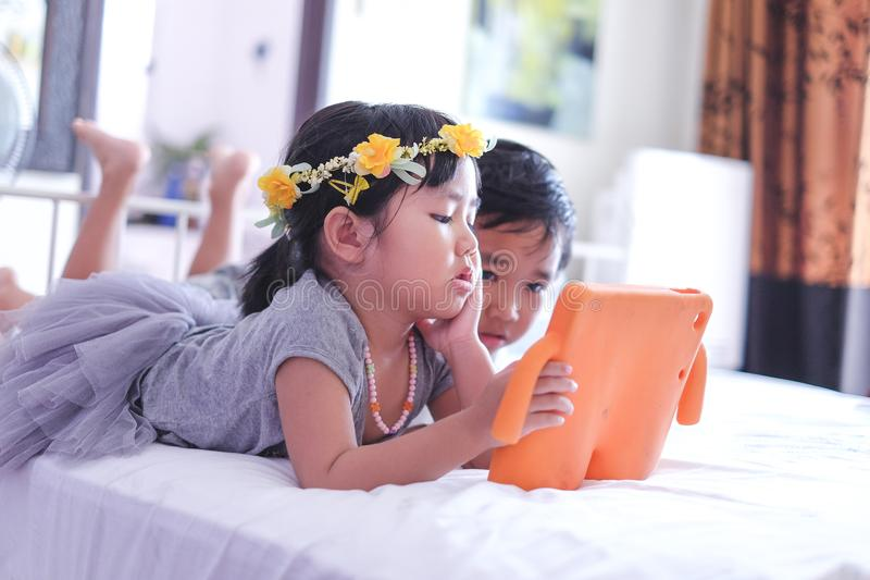 Kids watching online video on tablet stock photo