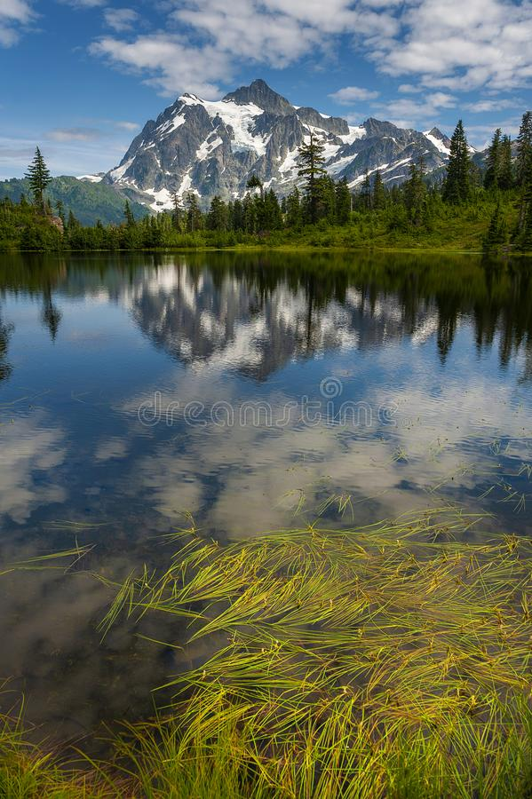 Picture Lake with Mt. Shuksan, Washington state. Picture Lake is the centerpiece of a strikingly beautiful landscape in the Heather Meadows area of the Mt royalty free stock image