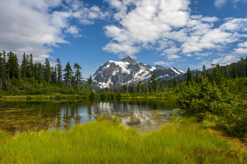 Picture Lake with Mt. Shuksan, Washington state. Picture Lake is the centerpiece of a strikingly beautiful landscape in the Heather Meadows area of the Mt stock images