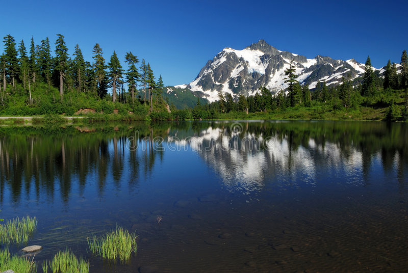 Picture lake and mt shuksan. Mt. shuksan and reflection on picture lake stock photography