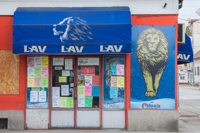 Logo of Lav Beer Lav Pivo, one of the main Serbian Light Beers on one of their shops. Picture of a Lav Beer Lav Pivo shop in eastern Serbia with its distincitve stock images
