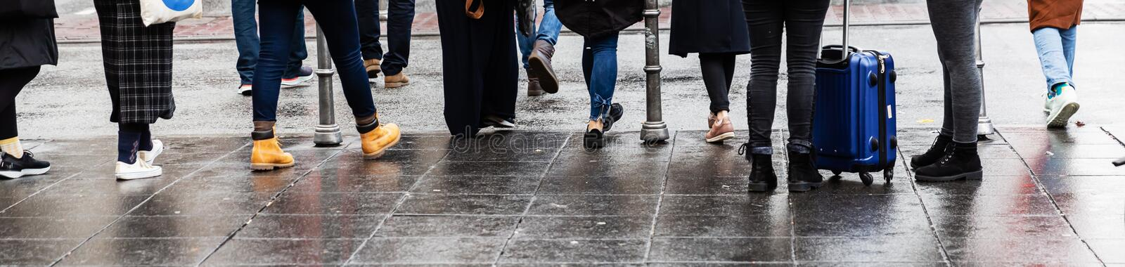 Legs of a crowd of people standing at the pedestrian crossing royalty free stock photography