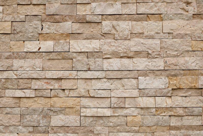 Light brown brick wall textured stock photography