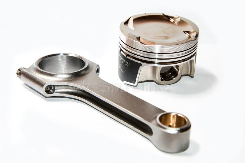 Light forged sport and racing piston and connecting rod royalty free stock photo