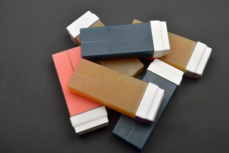 Picture of liposoluble wax cartridges for waxing on black backgroung.  stock images
