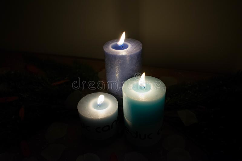 Three lit candles illuminating the picture royalty free stock photography